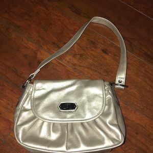 small outside but big inside purse